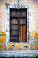 Window with closed shutter and metal grill in Puebla, Mexico