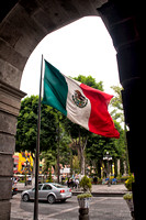 Mexican flag near zocalo in downtown Puebla, Mexico