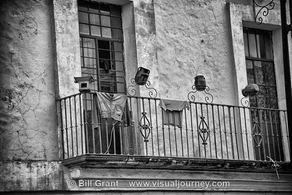 Clothes hanging from balcony in Puebla, Mexico