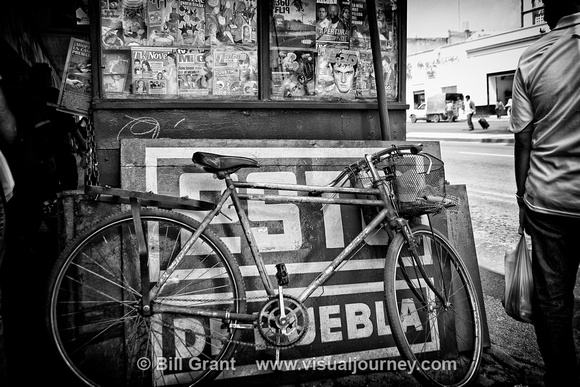Bicycle leaning against a newsstand in Puebla, Mexico